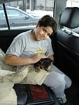 Our son Matthew picking up the seven week old puppie Riku near Jim Thorpe, PA.