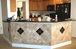 Tile backsplash under kitchen bar